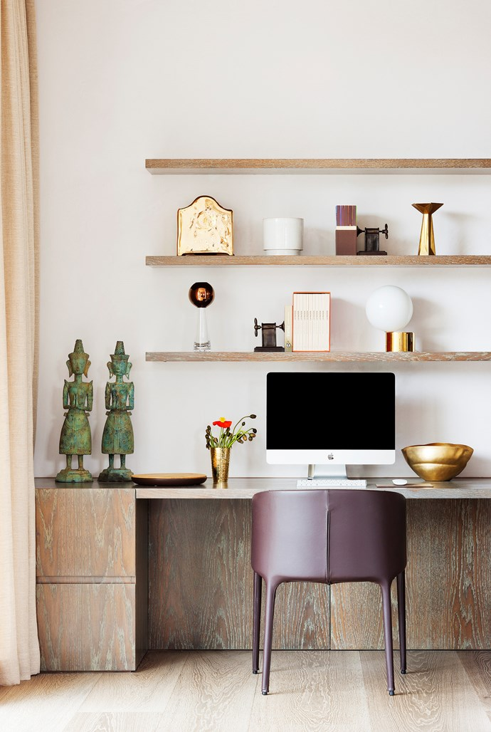 The shelves in the study area of this Rob Mills-designed home in Melbourne's South Yarra hold an assemblage of objects found on the owner's frequent trips abroad. *Photograph*: Shannon McGrath | *Styling*: Imogene Roache. From *Belle* April 2016.