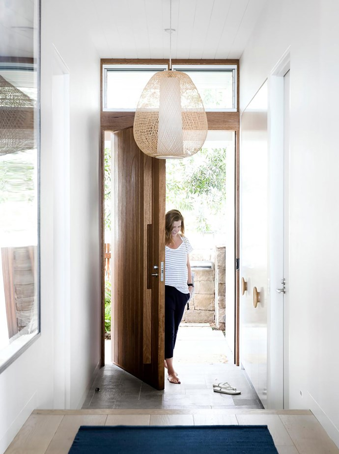 Rachel Defina enters her newly built northern beaches home. 'Twiggy Egg' pendant light, Spence & Lyda. Granite floor tiles, Surface Gallery. Artwork by Sophia Szilagyi.