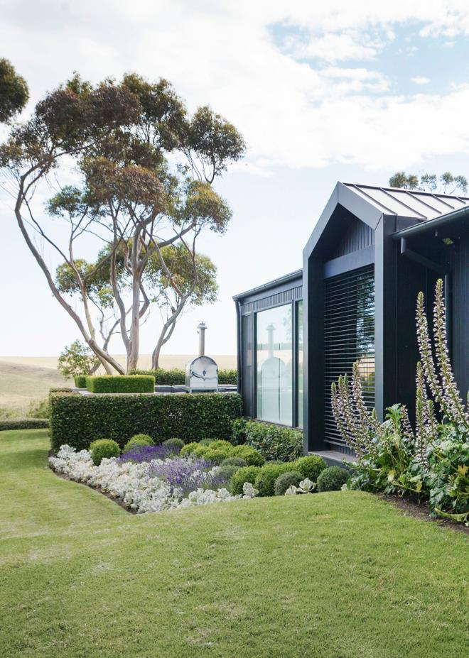 "This [sophisticated yet naturalistic garden](https://www.homestolove.com.au/manicured-garden-victoria-mornington-peninsula-5915|target=""_blank"") by landscape designer Ben Scott has a harmonious medley of elements and a sense of calm befitting its setting on Victoria's Mornington Peninsula. *Photo*: Simon Griffiths."