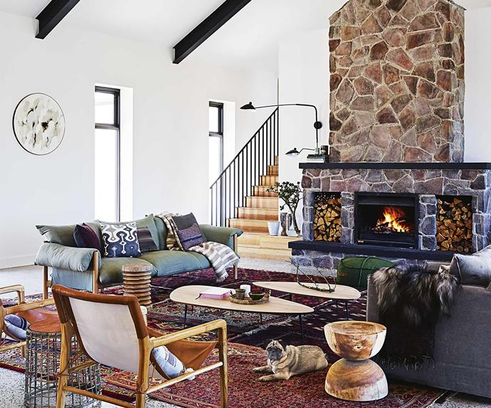 Modern country style farmhouse living room with stone fireplace