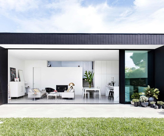 "**Living area** [Aluminium doors and windows](https://www.homestolove.com.au/how-to-choose-doors-and-windows-18928|target=""_blank"") in anodised satin black finish from [Aluminium & Glass Constructions](http://aluminiumandglassconstructions.com.au/