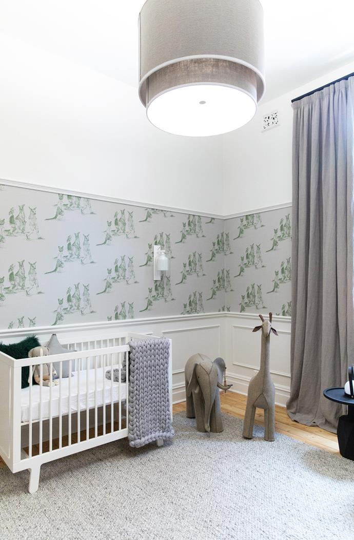 "Wall mouldings combined with a wallpaper feature wall create a classic look in [Nadia Bartel's new nursery](https://www.instagram.com/littlelibertyrooms/|target=""_blank""