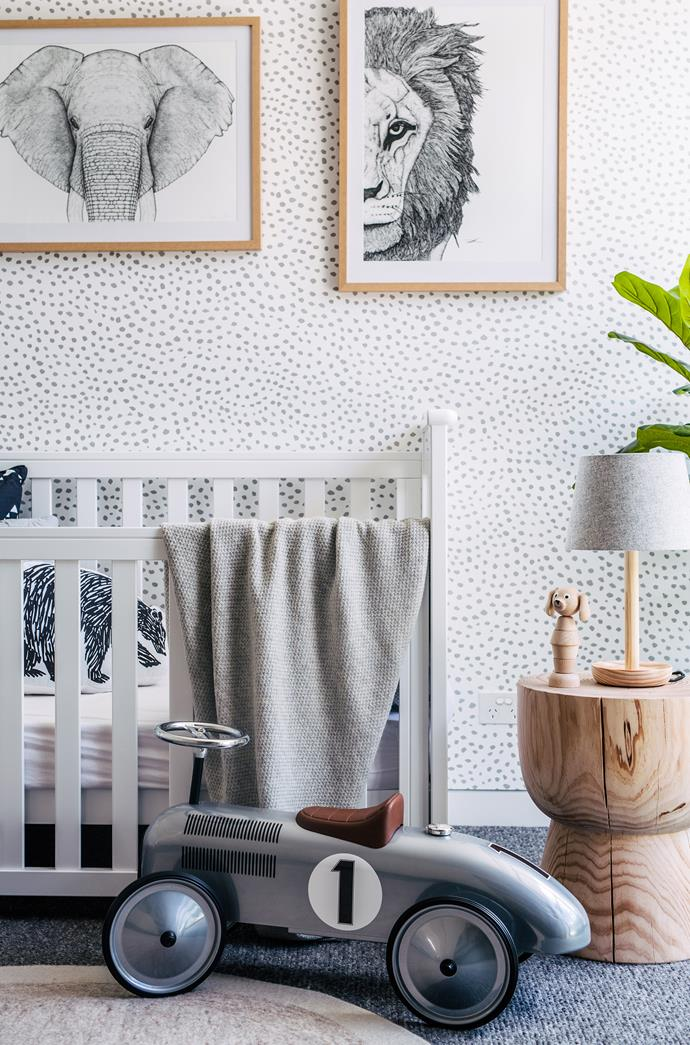 Wallpaper and framed prints bring this neutral nursery to life.