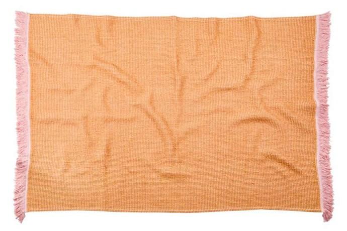 "'Harlow' waffle bath sheet in Ochre, $79, [Sage x Clare](https://sageandclare.com/|target=""_blank""|rel=""nofollow"")."
