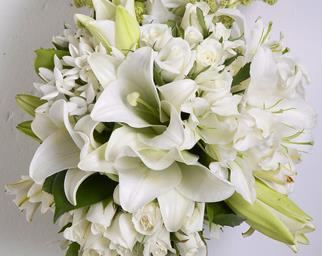 Wedding bouquet of white flowers including calla lilies and roses