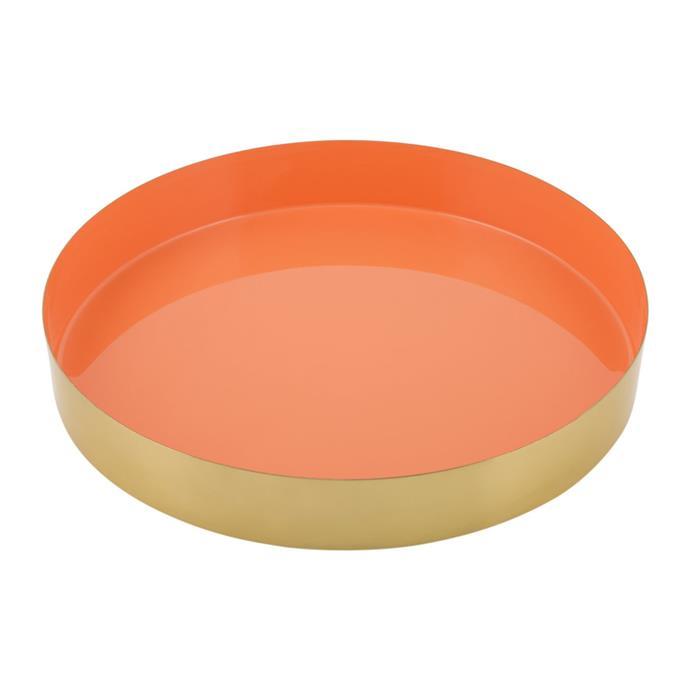 "Carousel tray in Gold/Orange, $59, [Amara](https://fave.co/2T5nLaf|target=""_blank""|rel=""nofollow"")."