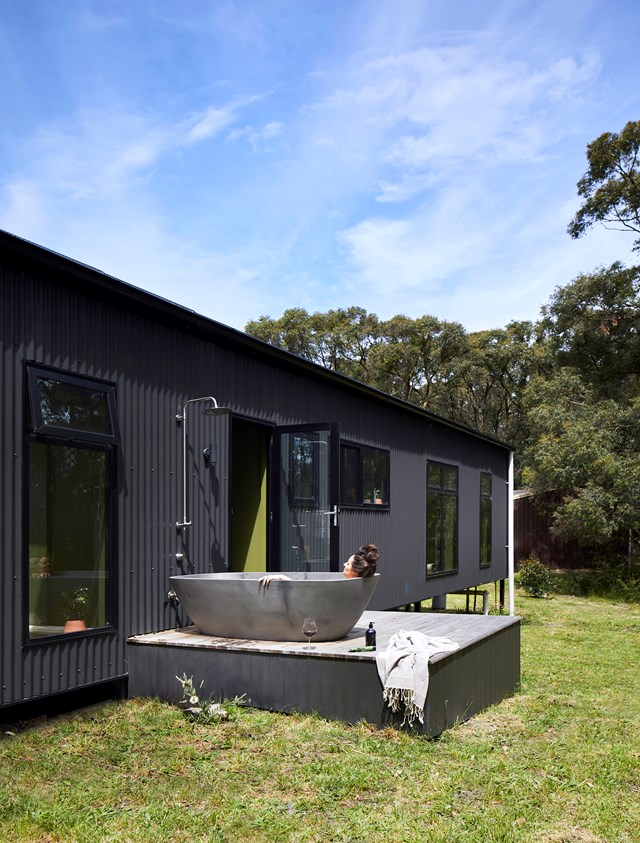 "Simone loves relaxing in her beautiful stone bath, built into the deck of her [sustainable home in rural Victoria](https://www.homestolove.com.au/sustainable-retreat-in-victoria-19634|target=""_blank"")."