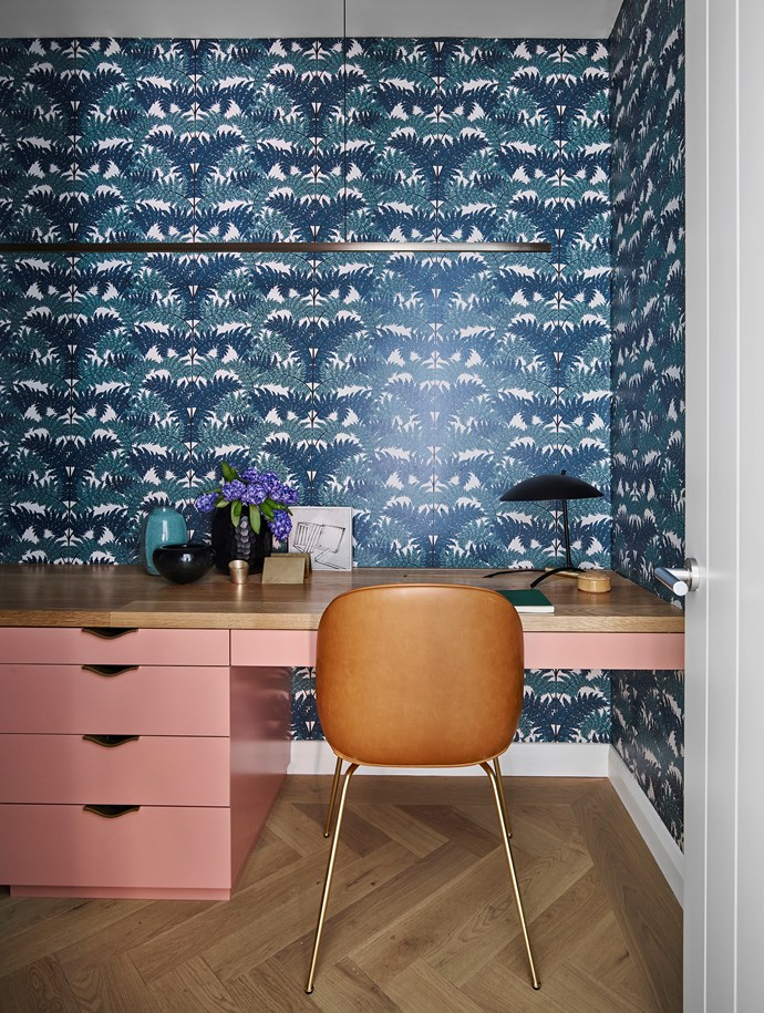 A Gubi 'Beetle' chair in tan complements the salmon-hued joinery in this study nook designed by Arent&Pyke. *Photograph*: Anson Smart. From *Belle* December/January 2018/19.