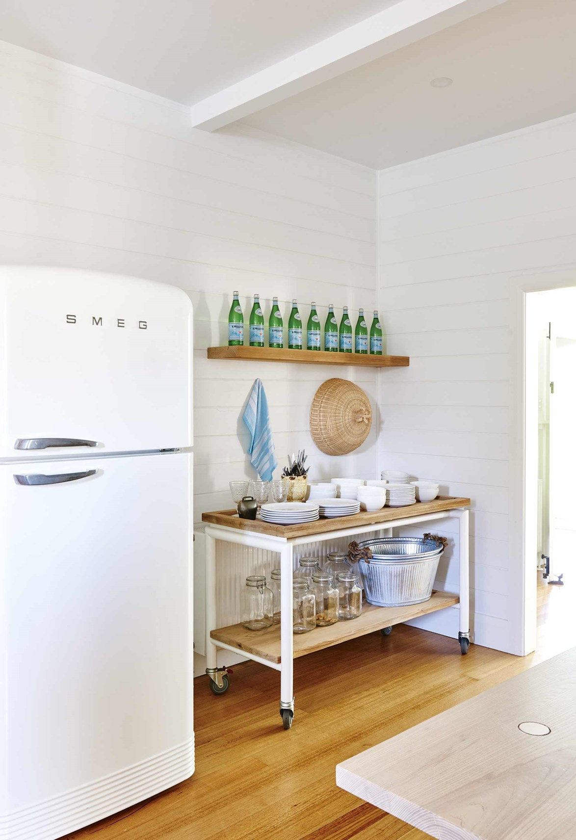 "<p>**PORTABLE SHELVING**<P> <p> Pinched for space? Then a portable kitchen island shelf or kitchen trolley could be the solution. This idea, which has been executed to a T in this renovated [Californian bungalow in Barwon Heads](https://www.homestolove.com.au/californian-bungalow-barwon-heads-17909|target=""_blank"") works especially well for those who love to entertain frequently. Having a barbeque? Just wheel the trolley out to the verandah. There's no need to take multiple trips to the kitchen for more cups, cutlery and plates.<p> <p>*Photo: Nikole Ramsay / Story: Inside Out*<p>"