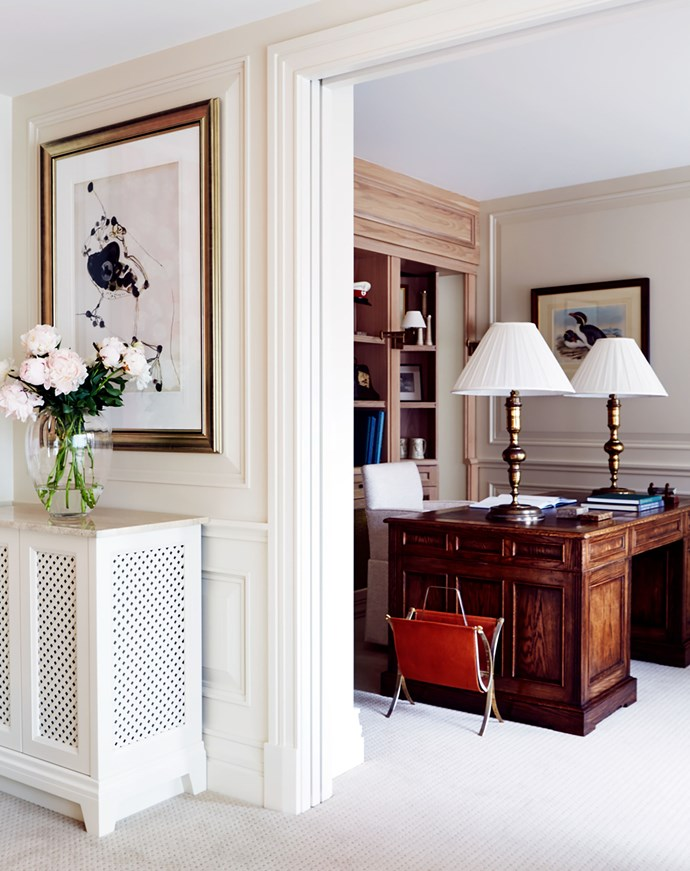 The owners of this apartment decorated by the late Stuart Rattle enlisted interior designer Charlotte Coote to connect a newly acquiring neighbouring flat and convert it into a 'his and hers' study. Oak desk by Robert Brown. Charlotte Coote created the 'Crom' desk chair which is upholstered in GP & J Baker 'Athlone' viscose blend in Natural from Elliott Clarke. The Spanish 19th-century lap bases were bought in France feature box-pleated ivory silk shades designed by Coote&Co and amde by Cromwell. *Photograph*: Christine Francis. From *Belle* August/September 2016.
