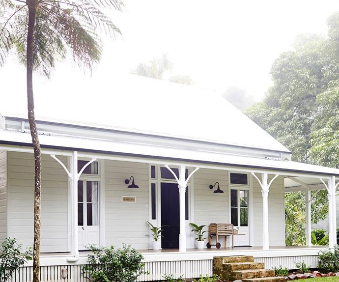 Exterior cottage facade painted white with wraparound verandah