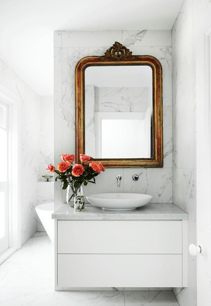 The antique-style mirror from Imagine This in this elegant bathroom adds a vintage component to the light-filled space. *Photograph*: Prue Ruscoe | *Styling*: Lucy McCabe. From *Belle* February/March 2019.