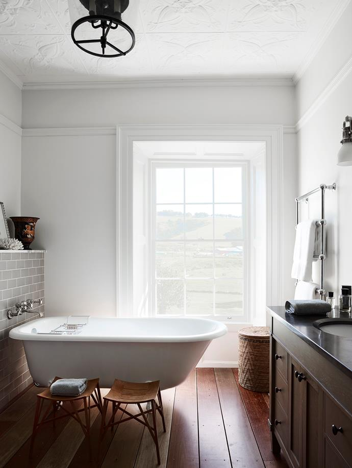 At a historic homestead run as a B&B by interior design Darryl Gordon, the upstairs ensuite boasts a Victoria & Albert freestanding bathtub equipped with tapware from Lefroy Brooks, and reclaimed turpentine floors from Ironwood Australia. *Photograph*: Anson Smart. From *Belle* November 2018.