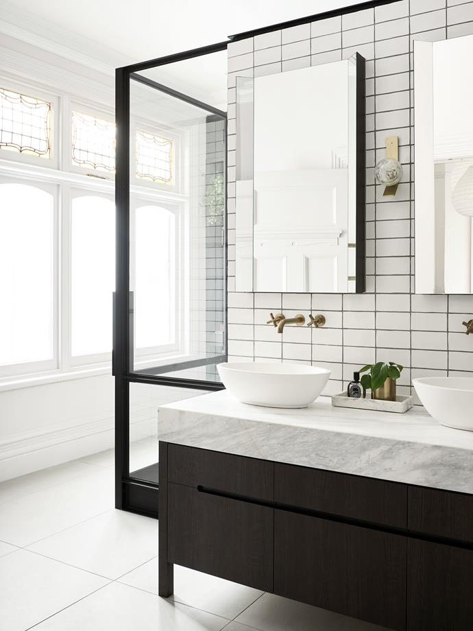 Richard Newling Ward of interiors and architecture practice BayleyWard was enlisted to revamp this Edwardian home in Melbourne. Leadlights in the main bathroom were relocated from elsewhere in the house and Lavamani washbasins from Rogerseller were installed. *Photograph*: Eve Wilson | *Styling*: Claire Larritt-Evans. From *Belle* May 2018.