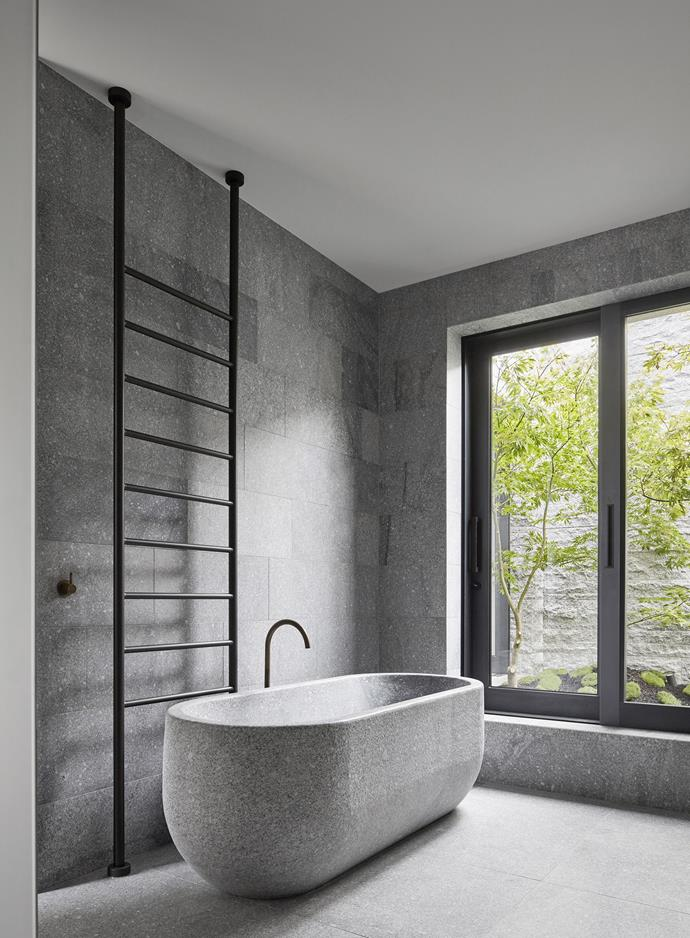This bathroom designed by B.E Architecture is distinguished by its use of three types of granite (for the facade as well as the interiors) from Eco Outdoor. *Photograph*: Peter Clarke. From *Belle* October 2018.