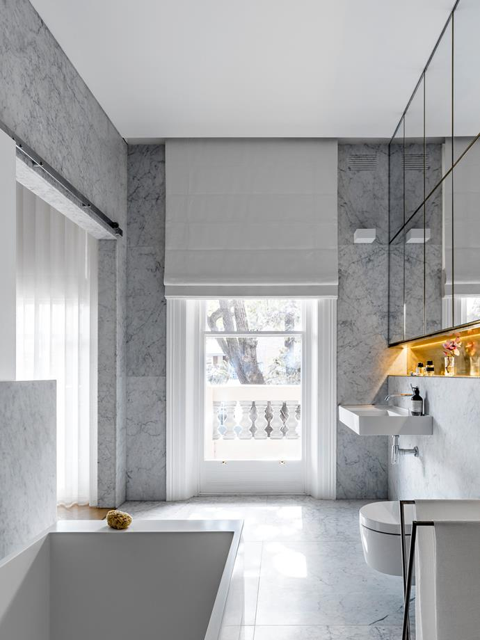 Renato D'Ettorre of Renato D'Ettorre Architects designed this crisp and contemporary bathroom that has been swathed in honed Carrara marble from Nefiko Marble. *Photograph*: Justin Alexander. From *Belle* February/March 2019.