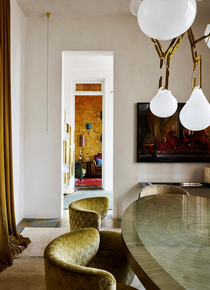 A Christopher Boots 'Nepenthes' chandelier hangs above the dining table.