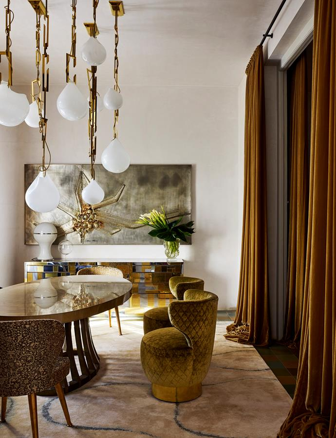 Christian Lyon for Matsuoka 'Opera' table and custom-designed swivel chairs in quilted velvet with brass base. Vintage Paul Evans 'Cityscape' series credenza from London. Belgian wall sculpture in aluminium by Marc D'Haenens.