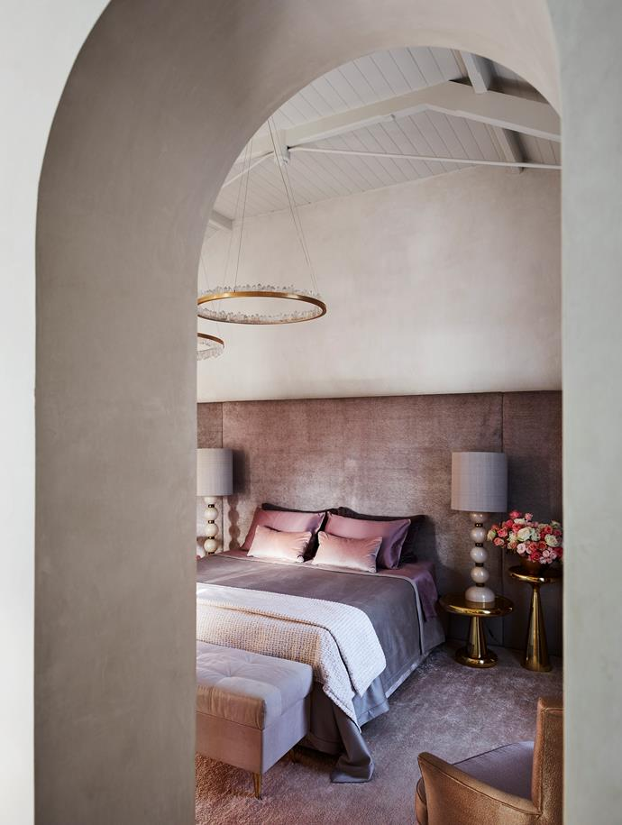'Prometheus 1+11' pendant lights by Christopher Boots hang above a custom-designed bed in Dedar velvet from South Pacific Fabrics. Vintage Murano glass lamps with silk shades from Editeur. Cashmere rug from Robyn Cosgrove.