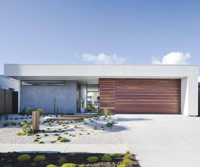 "**Exterior** The [facade](https://www.homestolove.com.au/18-home-facades-to-inspire-2925|target=""_blank"") is a homage to classic Palm Springs style with a modern Australian edge, thanks to spotted gum cladding on one side and a Rockcote 'Marrakesh' finish on the other."