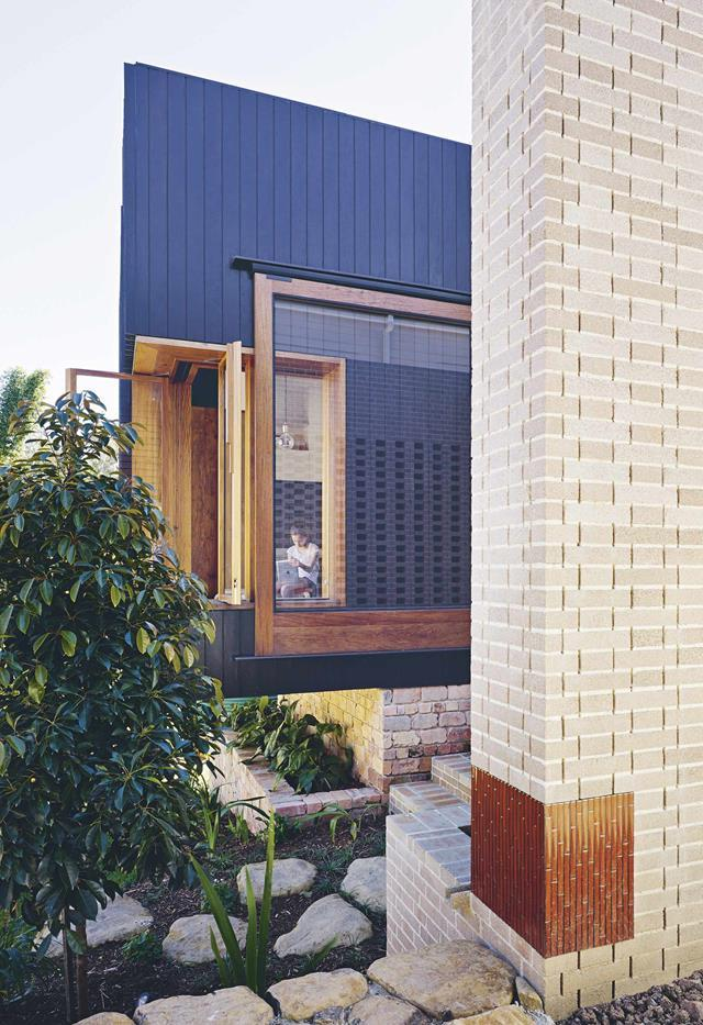 "The new living area is cantilevered over the garden. An original brick chimney at the front of the house is referenced in [new brickwork](https://www.homestolove.com.au/queenslander-cottage-with-indoor-outdoor-living-19380|target=""_blank"") at the rear. *Photo*: Christopher Frederick Jones 