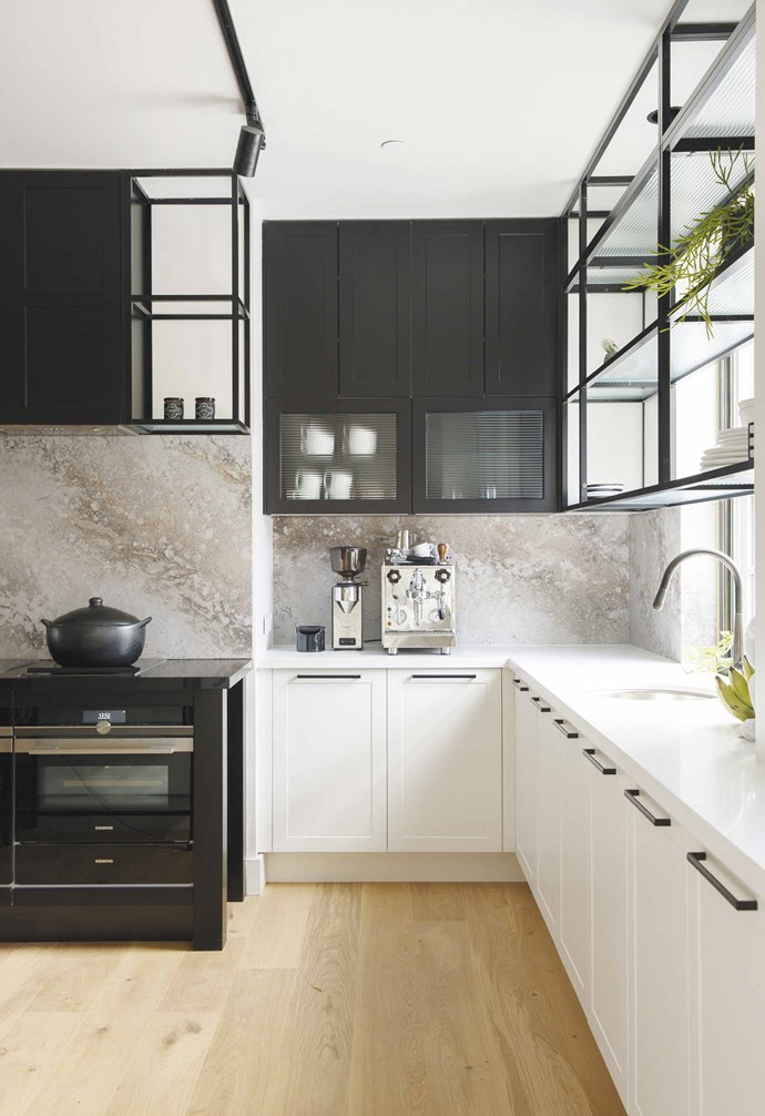 """**Open shelving** """"One trend we see gaining momentum for kitchen design in 2019 is using contemporary open-frame shelving to create a cafe-style feel. Our new '2020 Alumin' matt black frames with glass shelving are the perfect pairing for other on-trend black elements and also lends the opportunity to style decor – which is a great way to connect your [open-plan living spaces](https://www.homestolove.com.au/20-best-open-plan-living-designs-17877