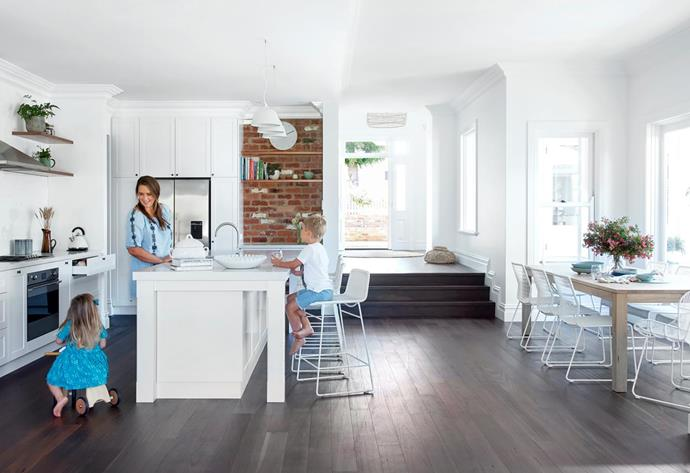 The bright and spacious kitchen/dining area has a practical roasted-peat hardwood floor. Behind the rear wall (at left) are a scullery, laundry and drop zone en route to the garage. Caesarstone benchtop in Frosty Carrina. Joinery by Streamline Cabinets. Flooring, BJ's Timber Flooring. Designer buy: GlobeWest 'Granada Butterfly' iron and resin-weave carver chairs, $590 each, and 'Granada Twist' dining chairs, $545 each, all Cranmore Home.