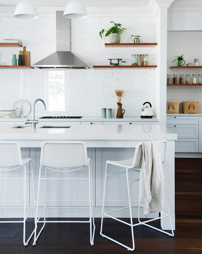 Smart and cost-effective, the splashback is white-painted recycled brick fronted by a pane of glass. GlobeWest 'Olivia' bar stools, Cranmore Home. Sussex 'Scala' kitchen mixer, Reece. Designer buy: Muuto 'Ambit Rail' lamp, $1280, Living Edge