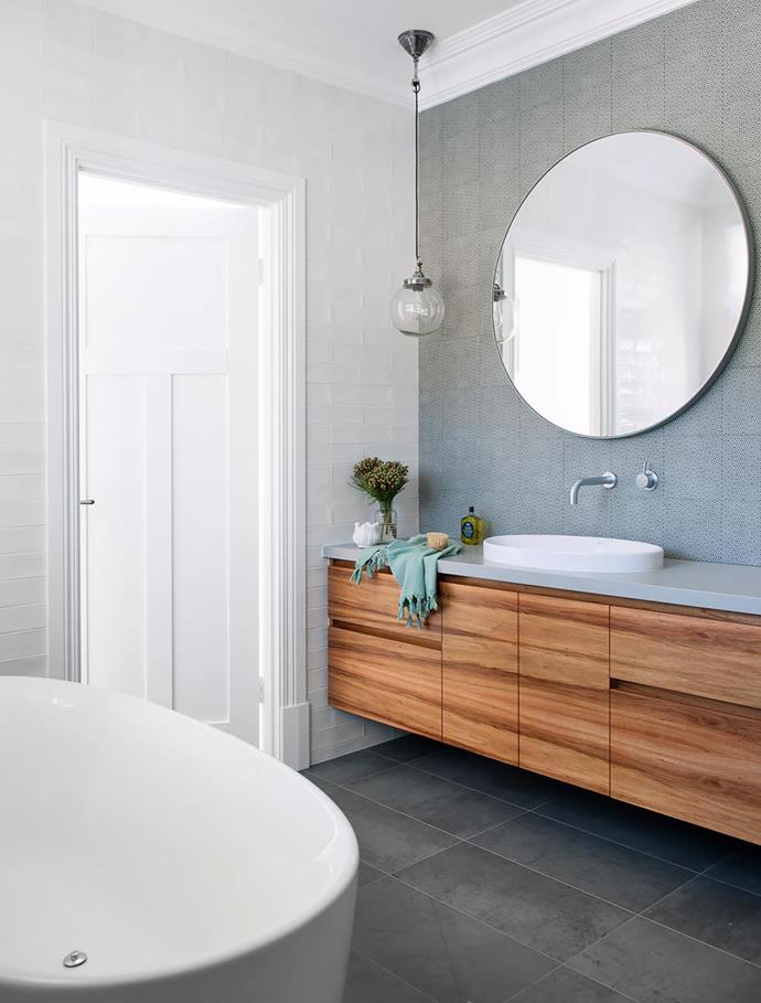 Tasmanian blackwood cabinetry is built into all the bathrooms. Caesarstone Raw Concrete benchtop. Bath, basin and tapware, Reece. Tiles, Myaree Ceramics. Pendant light and mirror, Cranmore Home.
