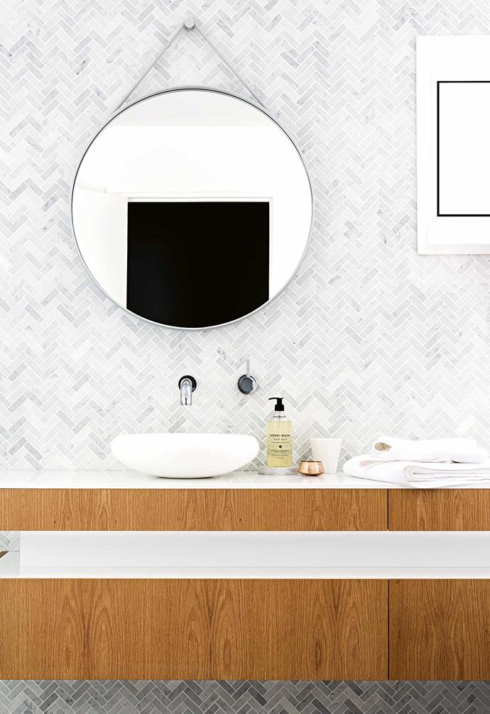 "**Classically trained** The home's three bathrooms – the [ensuite](https://www.homestolove.com.au/ensuite-bathroom-design-ideas-18820|target=""_blank""), the guest bathroom and the [powder room](https://www.homestolove.com.au/powder-rooms-that-make-serious-style-statements-17987