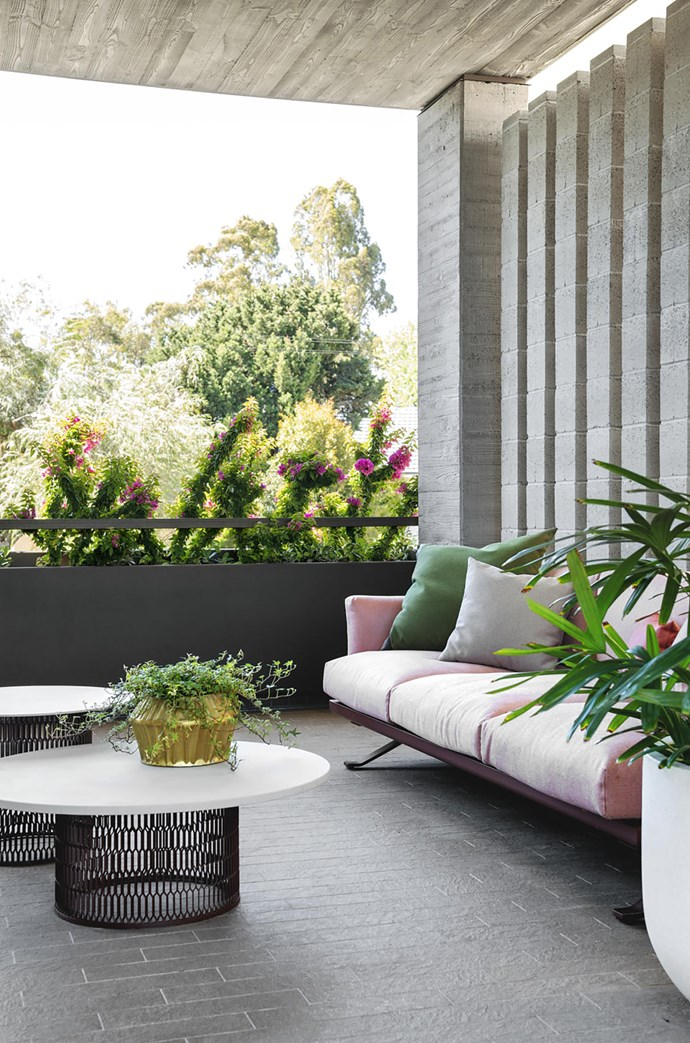 The terrace looks over nearby nature reserve Bolt Park and is furnished with Kettal 'Mesh' coffee tables and 'Boma' three-seater sofa, all from Mobilia.