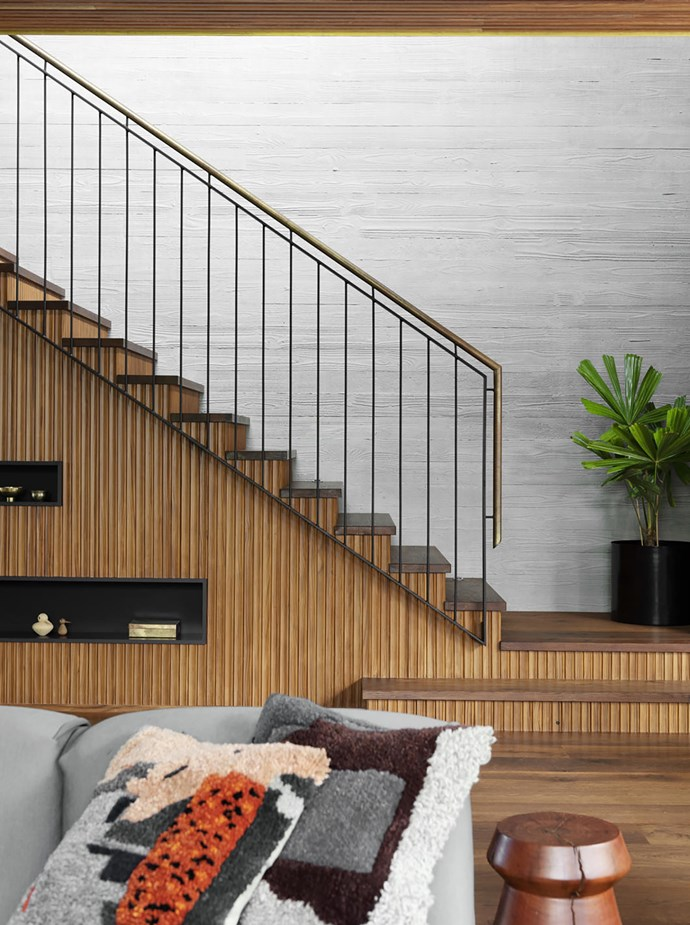 The repetition of ribbed timberwork is seen throughout the house, including on the staircase.