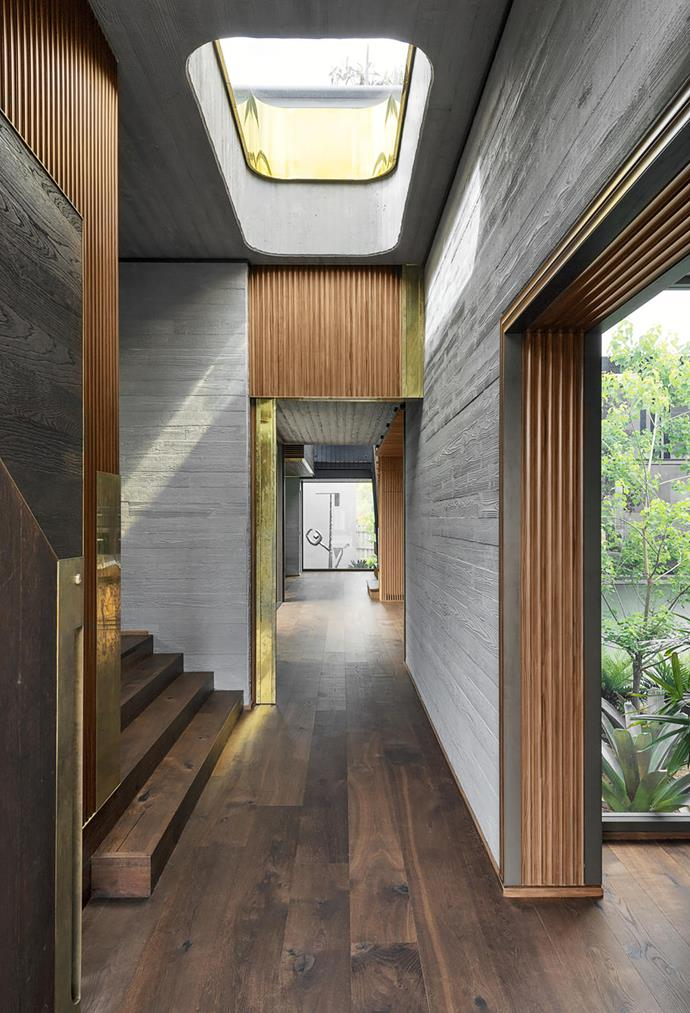 Textured materials such as matt cement and ribbed timbers set the mood as you walk through the house, while gardens and courtyards form part of every vantage point