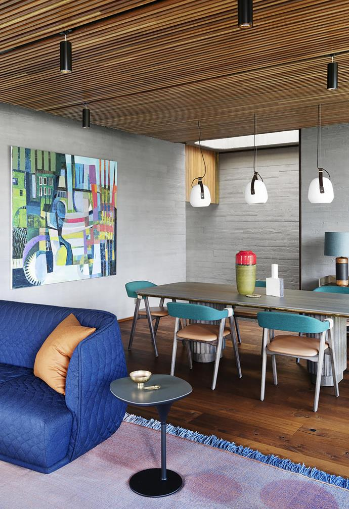 Moroso 'Mathilda' dining chairs by Patricia Urquiola from Mobilia surround a custom table by architect Neil Cownie with Rakumba 'Stone Cow' pendant lights above. Artwork by Kate Elsey.