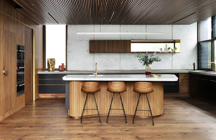 Lapalma 'Miunn' bar stools in the kitchen, which is clad in Statuarietto marble and lit by a Rakumba 'Potter DS' pendant light by Anchor Ceramics.