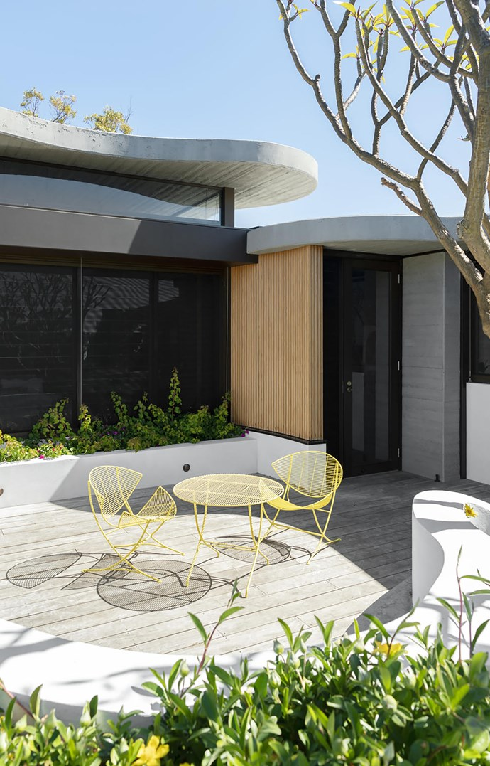 Making the most of garden spaces was imperative to the clients and the extended rooftop garden on the second level brings the garden into the master bedroom. Vintage wire-framed outdoor table and chairs.