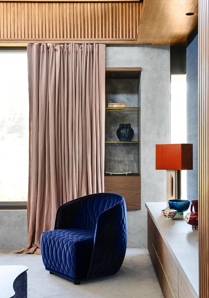 In the master bedroom, Moroso 'Redondo' armchair by Patricia Urquiola from Mobilia with curtains in Pierre Frey linen.