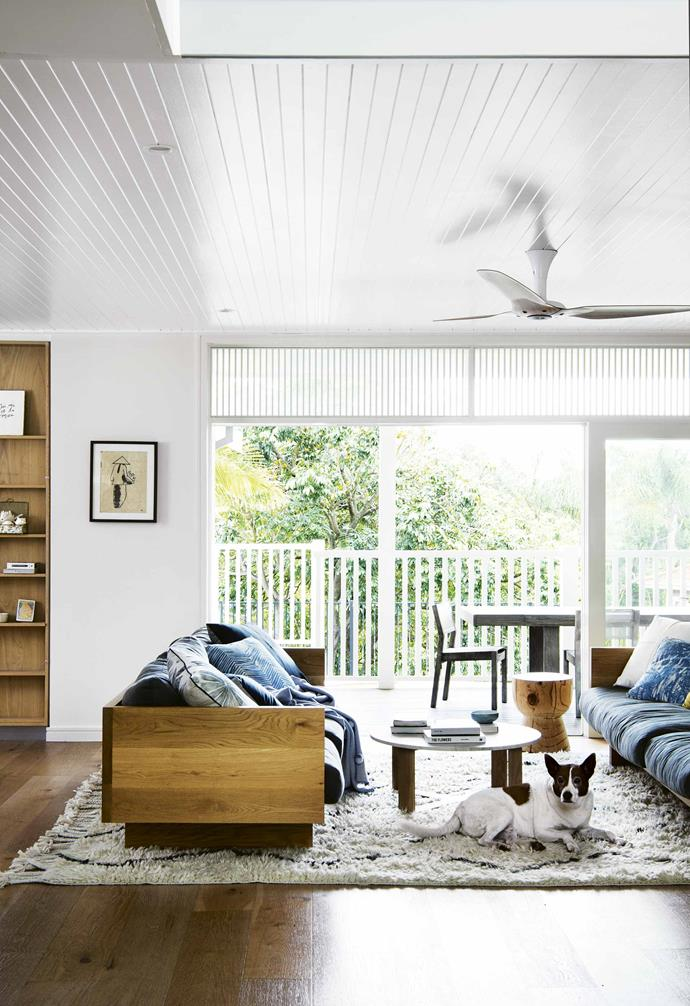 """**Sightlines** The furniture arrangement in this [beachside home](https://www.homestolove.com.au/how-to-create-the-beachside-look-with-natural-light-and-timber-17440