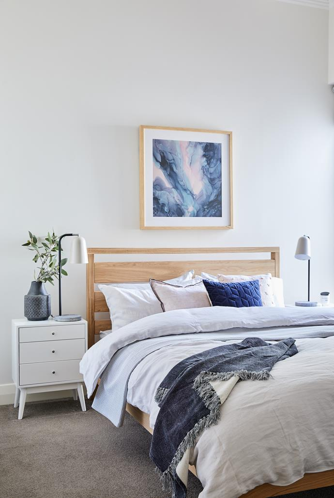 "[Scandinavian style furniture](https://www.homestolove.com.au/scandi-style-furniture-6972|target=""_blank"") and a neutral colour palette with pops of pink and blue create a bedroom that's soft but not too girly."