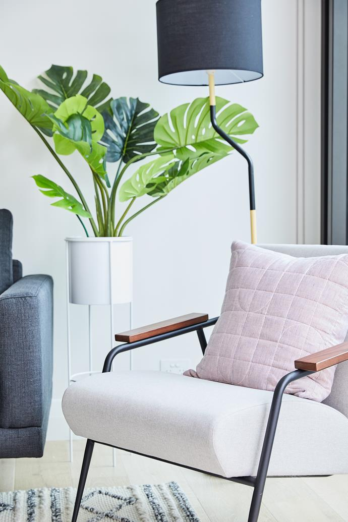 A Mid-century style chair with timber armrests adds warmth and character to the space.