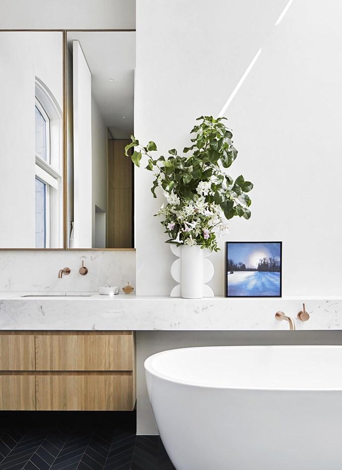 In a bathroom, 'Lunar' vase by Sarah Ellison, and Ciney Snow, Belgium artwork by Kirrily Hammond.