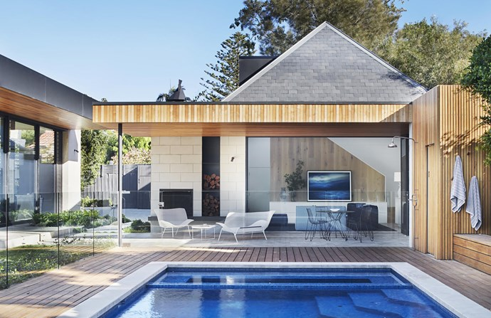 The new pool cabana has a Ligne Roset 'Grillage' settee and armchair from Domo. Artwork, Breathe by Mark Tipple from Otomys