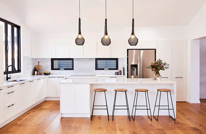 """This kitchen embraces a more contemporary approach to the Hampton's style, with Shaker-style cabinetry accented with sleek, dark handles. *Image: Supplied / [Kinsman](https://kinsman.com.au/kitchens/