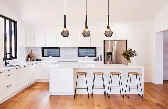 "This kitchen embraces a more contemporary approach to the Hampton's style, with Shaker-style cabinetry accented with sleek, dark handles. *Image: Supplied / [Kinsman](https://kinsman.com.au/kitchens/|target=""_blank""