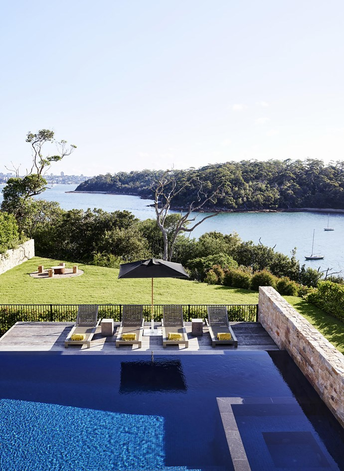 A Sydney home designed by Justine-Hugh Jones boasts expansive views to the pool and harbour beyond. *Photograph*: Anson Smart | *Styling*: Steve Cordony. From *Belle* April 2018.