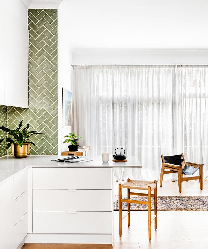 This green tiled splashback utilises an interesting pattern to create greater visual interest in this otherwise clean-lined kitchen. *Photo: Amelia Stanwix / bauersyndication.com.au*