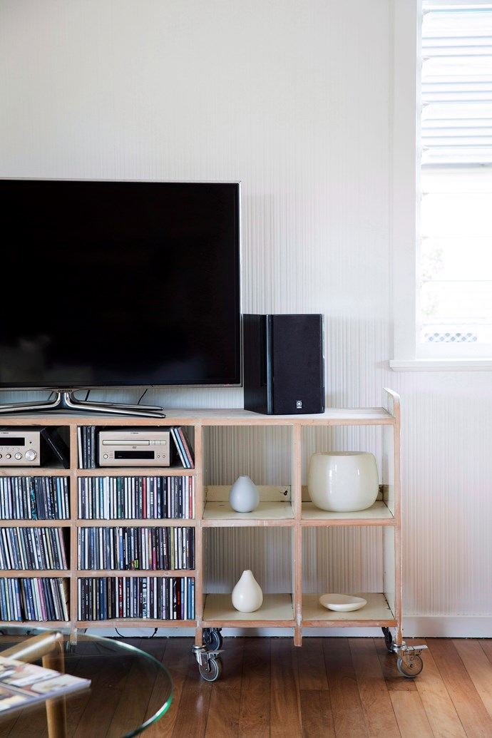A stylish TV unit keep cords out of sight. *Photo:* James Henry