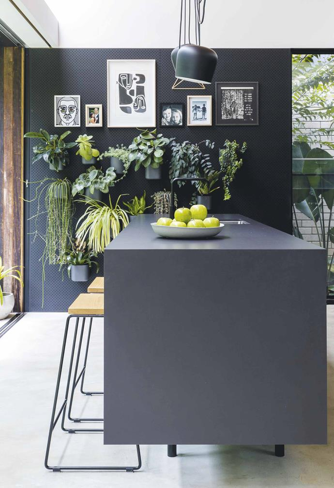 "**Kitchen** Basic black formwork sheets were used to construct the kitchen joinery in Steve's Sydney home. The benchtop comprises 12mm-thick porcelain panels from Artedomus, and the custom stools are by Exit Eighty Six. A wedding photograph and photos of his children Aalto and Paradis fill a pre-drilled MDF wall along with (from left) [Craig & Karl](http://craigandkarl.com/|target=""_blank""