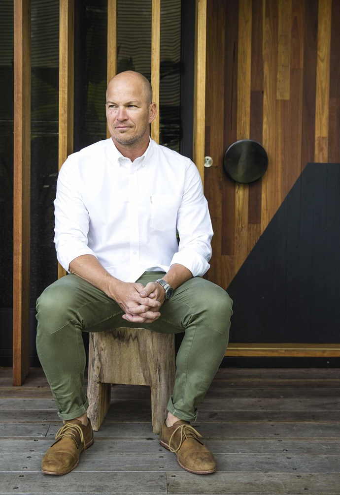 **Exterior** Homeowner Steve sits on a stool crafted from a log found in a neighbour's front yard.