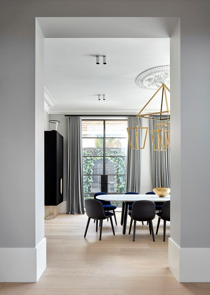Designer Christopher Elliott was engaged to work on the revamp of this c1800s house in an inner Melbourne suburb. Custom wall unit and dining table by Christopher Elliott Design. 'Mad' dining chairs from Poliform. *Photograph*: Jack Lovel. From *Belle* November 2018.